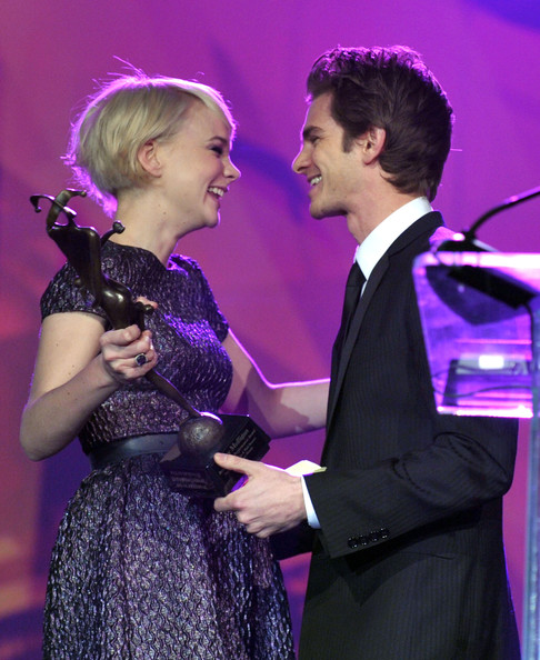"Carey Mulligan Actress Carey Mulligan (L) accepts the ""Breakthrough Performance Award"" from actor Andrew Garfield (R) onstage during the 22nd Annual Palm Springs International Film Festival Awards Gala at the Palm Springs Convention Center on January 8, 2011 in Palm Springs, California."
