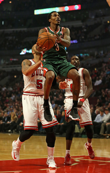 Milwaukee Bucks v Chicago Bulls [photograph,sports,basketball player,ball game,basketball moves,player,tournament,sport venue,team sport,basketball,basketball court,brandon jennings 3,user,user,carlos boozer 5,loul deng 9,note,terms,milwaukee bucks,chicago bulls]