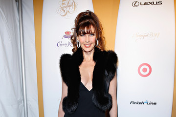 Carol Alt Captain Morgan White Rum And Crown Royal XO Raise A Glass To Sports Illustrated Swimsuit Issue