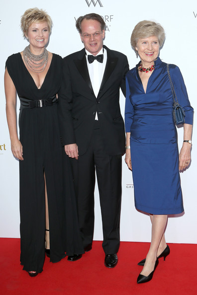 Waldorf Astoria Berlin Grand Opening [suit,clothing,formal wear,carpet,dress,premiere,pantsuit,tuxedo,fashion,red carpet,carola ferstl,friede springer,anton voglmaier,l-r,waldorf astoria berlin,germany,waldorf astoria berlin grand opening]