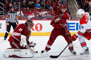 Goaltender Mike Smith #41 of the Arizona Coyotes makes a save on a shot as Antoine Vermette #50 defends Jay McClement #18 of the Carolina Hurricanes during the second period of the NHL game at Gila River Arena on February 5, 2015 in Glendale, Arizona.