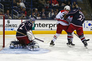 James Wisniewski #21 of the Columbus Blue Jackets checks Patrick Dwyer #38 of the Carolina Hurricanes as Sergei Bobrovsky #72 of the Columbus Blue Jackets deflects the puck during the third period on September 26, 2013 at Nationwide Arena in Columbus, Ohio. Carolina defeated Columbus 2-1.