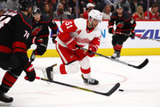 Frans Nielsen #51 of the Detroit Red Wings tries to control the puck while playing the Carolina Hurricanes during the second period at Little Caesars Arena on October 22, 2018 in Detroit, Michigan.