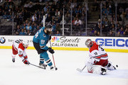 Brent Burns #88 of the San Jose Sharks scores the game-winning goal on Cam Ward #30 of the Carolina Hurricanes in overtime at SAP Center on December 7, 2017 in San Jose, California.  (Photo by Ezra Shaw/Getty Images) *** Local Caption *** Brent Burns; Cam Ward