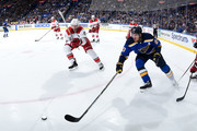 Jordan Staal #11 of the Carolina Hurricanes and Alexander Steen #20 of the St. Louis Blues reach for the puck at Scottrade Center on December 30, 2017 in St. Louis, Missouri.