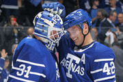 Tyler Bozak #42 of the Toronto Maple Leafs congratulates teammate Frederik Andersen #31 after defeating the Carolina Hurricanes in an NHL game at the Air Canada Centre on December 19, 2017 in Toronto, Ontario, Canada. The Maple Leafs defeated the Hurricanes 8-1.