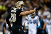 Jimmy Graham #80 of the New Orleans Saints reacts after catching a pass against the Carolina Panthers at Mercedes-Benz Superdome on December 8, 2013 in New Orleans, Louisiana.