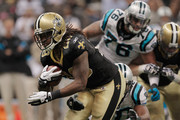 Chris Ivory #29 of the New Orleans Saints is tackled by  James Anderson #50 of the Carolina Panthers at the Mercedes-Benz Superdome on January 1, 2012 in New Orleans, Louisiana.  The Saints defeated the Panthers 45-17.