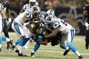 Chris Ivory #29 of the New Orleans Saints is tackled by Captain Munnerlyn #41, D.J. Campbell #26 and Thomas Davis #58 of the Carolina Panthers at Mercedes-Benz Superdome on December 30, 2012 in New Orleans, Louisiana.  The Panthers defeated the Saints 44-38.