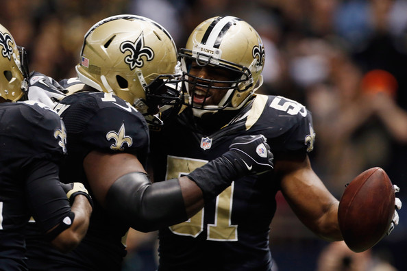 Jonathan Vilma #51 of the New Orleans Saints celebrates after scoring