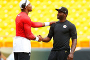 Michael Vick #2 of the Pittsburgh Steelers talks with Cam Newton #1 of  the Carolina Panthers while warming up prior to the preseason game at Heinz Field on September 3, 2015 in Pittsburgh, Pennsylvania.