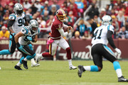 Quarterback Alex Smith #11 of the Washington Redskins runs with the ball in the first quarter against the Carolina Panthers at FedExField on October 14, 2018 in Landover, Maryland.