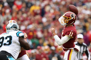 Quarterback Alex Smith #11 of the Washington Redskins throws a touchdown in the first quarter against the Carolina Panthers at FedExField on October 14, 2018 in Landover, Maryland.