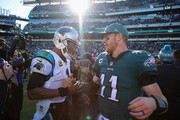 Quarterback Carson Wentz #11 (R) of the Philadelphia Eagles congratulates quarterback Cam Newton #1 (L) of the Carolina Panthers on their win at Lincoln Financial Field on October 21, 2018 in Philadelphia, Pennsylvania. The Panthers won 21-17.