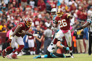 Running back Adrian Peterson #26 of the Washington Redskins runs with the ball in the fourth quarter against the Carolina Panthers at FedExField on October 14, 2018 in Landover, Maryland.