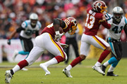 Running back Adrian Peterson #26 of the Washington Redskins loses his shoe as he rushes with the ball against the Carolina Panthers during the second quarter at FedExField on October 14, 2018 in Landover, Maryland.
