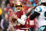 Quarterback Alex Smith #11 of the Washington Redskins looks to throw the ball in the second quarter against the Carolina Panthers at FedExField on October 14, 2018 in Landover, Maryland.