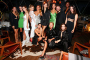 Alex Raisman, Olivia Perez, Elizabeth Sulcer, Shea Marie, Jennifer Yepez, Yasmin Wijnaldum, Alana Arrington, David Koma, Amilna Estevao, Julia Restoin Rotfeld, Sara Sampaio, Tina Leung and Barbara Palvin attend Caroline Rush, Julia Restoin Roitfeld and Bloomingdales Celebrate David Koma's 10th Anniversary at The Peninsula Hotel on October 30, 2019 in New York City.