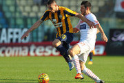 Artur Ionita of Hellas Verona FC competes for the ball with Andrea Lazzari of Carpi FC during the Serie A match between Carpi FC and Hellas Verona FC at Alberto Braglia Stadium on November 1, 2015 in Modena, Italy.