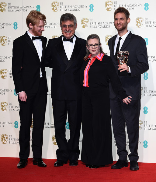 EE British Academy Film Awards - Winners Room [award,event,carpet,suit,red carpet,premiere,award ceremony,formal wear,tuxedo,white-collar worker,winners,domhnall gleeson,carrie fisher,award,language,room,ee,2r,l,british academy film awards]