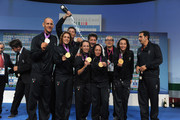 Alessio Sartori (1th R), Romano Battisti (1th L) silver medal in Rowing, Valentina Vezzali (2nd L) ,Arianna Arrigo (3rd L), Ilaria Salvatori (3rd R) , Elisa Di Francisca (2nd R)  gold medal in women's foil fencing team celebrate for  the medal in Casa Italia at London 2012 Olympic Games at The Queen Elizabeth II Conference Centre on July 29, 2012 in London, England.