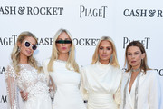 (L-R) Paris Hilton, Amanda Cronin, Caroline Stanbury and Juliet Angus attend the Piaget White Evening at La Reserve, Geneva, the third out of four stops on the all-female charity drive Cash & Rocket, on June 08, 2019 in Geneva, Switzerland.