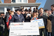 """(EXCLUSIVE COVERAGE) (9th from L-R) Actors Julianna Margulies, Chris Noth, Archie Panjabi, Matt Czuchry, and Zach Grenier present a check to the St. Bernard Project as The Cast Of """"The Good Wife"""" Celebrate Their100th Episode With A Day Of Service For The St. Bernard Project on October 26, 2013 in New York City."""