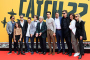 (L-R) Grant Heslov, Viola Pizzetti, George Clooney, Giovanni Stocchino, Domenico Cuomo, Giancarlo Giannini, Christopher Abbott, Kyle Chander, Richard Brown, Tessa Ferrer and Ellen Kuras attend 'Catch-22' Photocall, a Sky production, at The Space Moderno Cinema on May 13, 2019 in Rome, Italy.