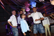 Fashion designers, founders and owners of Dsquared2 Dan Caten and Dean Caten dance with models at the Caten Hight School Prom DSquared2 as a part of Pitti Bimbo Kids Fashion Week at Palamattioli on June 21, 2018 in Florence, Italy.