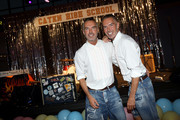 Fashion designers, founders and owners of Dsquared2 Dan Caten and Dean Caten pose fot a photo at the Caten Hight School Prom DSquared2 as a part of Pitti Bimbo Kids Fashion Week at Palamattioli on June 21, 2018 in Florence, Italy.
