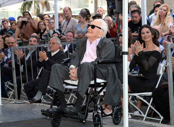 Hollywood Walk Of Fame Ceremony Honoring Michael Douglas [michael douglas,ron meyer,kirk douglas,catherine zeta-jones,product,fashion,event,sitting,baby carriage,baby products,hollywood boulevard,california,hollywood walk of fame ceremony]