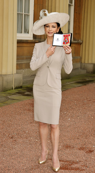 Catherine Zeta Jones Actress Catherine Zeta Jones poses after she was made a Commander of the British Empire (CBE) by the Prince of Wales at Buckingham Palace on February 24, 2011 in London, England. The 41-year-old Swansea-born actress Catherine Zeta Jones, who became an Oscar-winning Hollywood star was presented with a CBE by Prince Charles, Prince of Wale in honour of services to the film industry and to charity.