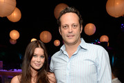 Actor Vince Vaughn (R) and wife Kyla Weber attend the 87th birthday celebration of Tony Bennett and fundraiser for Exploring the Arts, the charity organization founded by Mr. Bennett and wife Susan Benedetto, hosted by Ted Sarandos & Hon. Nicole Avant Sarandos among celebrity friends and family on August 3, 2013 in Beverly Hills, California.