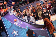 Shaquille O'Neal. and 2 Chainz play play pop-a-shot before the 2019 AT&T Slam Dunk Contest during the 2019 State Farm All-Star Saturday Night at Spectrum Center on February 16, 2019 in Charlotte, North Carolina.