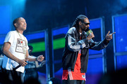 Musician Pharrell Williams (L) and Snoop Dogg perform onstage at the 63rd NBA All-Star Game 2014 at the Smoothie King Center on February 16, 2014 in New Orleans, Louisiana.