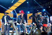 (L-R) Sean Combs, Pharrell Williams, Busta Rhymes, Nelly, and Snoop Dogg perform onstage at the 63rd NBA All-Star Game 2014 at the Smoothie King Center on February 16, 2014 in New Orleans, Louisiana.