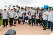 """Players pose for a team photo on the field at a charity softball game to benefit """"California Strong"""" at Pepperdine University on January 13, 2019 in Malibu, California."""
