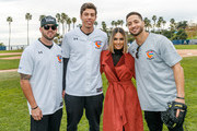 """Mike Moustakas, Christian Yelich, Pia Toscano and Ryan Braun attend a charity softball game to benefit """"California Strong"""" at Pepperdine University on January 13, 2019 in Malibu, California."""