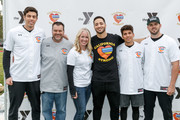 """Christian Yelich, Ronnie Stone, Megan Glynn, Ryan Braun, Mike Attanasio and Mike Moustakas attend a charity softball game to benefit """"California Strong"""" at Pepperdine University on January 13, 2019 in Malibu, California."""