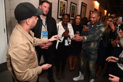 Dynamo performs card trick with Chris Eubank Jr backstage following the David Haye v Tony Bellew Fight at The O2 Arena on May 5, 2018 in London, England.