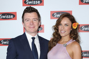 """Richard """"Rick"""" Astley and Jess McNamee attend the Swisse marquee on Stakes Day at Flemington Racecourse on November 10, 2012 in Melbourne, Australia."""
