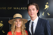 Torah Bright and Scott James at the Johnnie Walker Marquee on Stakes Day at Flemington Racecourse on November 8, 2014 in Melbourne, Australia.