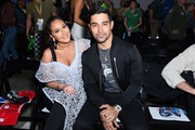Adrienne Bailon and Wilmer Valderrama attend the Monster Energy NASCAR Cup Series race at Auto Club Speedway at Auto Club Speedway on March 17, 2019 in Fontana, California.