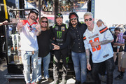 Tommy Lee, Vince Neil, Kurt Bush, Nikki Sixx and Machine Gun Kelly attend the Monster Energy NASCAR Cup Series race at Auto Club Speedway at Auto Club Speedway on March 17, 2019 in Fontana, California.