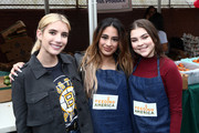 Emma Roberts, Ally Brooke and Hannah Zeile attend the Celebrity friends of Feeding America give back at the Para Los Niños Felices Fiestas to celebrate the holidays and raise awareness around the issue of hunger at Para Los Ninos Gratts Primary Center on December 14, 2019 in Los Angeles, California.