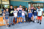 (L-R) Jonathan Bennet (4thL), Ali Larter (5thR), Boris Kodjoe (3rdR) and Emily Tosta (2ndR) and guests attend Celebrity Friends Of Feeding America volunteer at The Santa Monica Boys and Girls Club to raise awareness around summer hunger at Santa Monica Boys and Girls Club on July 17, 2019 in Culver City, California.