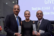 Honorees Former Attorney General Honorable Eric H. Holder, Jr., Obstetrics and Gynecology Surgeon Dr. Sharon Malone, and Senior Advocate of the Supreme Court of India Colin Gonsalves pose with awards onstage at The Center For Reproductive Rights 2015 Gala at The Museum of Modern Art on October 27, 2015 in New York City.