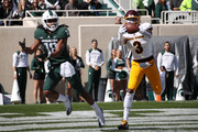 Sean Bunting #3 of the Central Michigan Chippewas intercepts a pass next to Felton Davis III #18 of the Michigan State Spartans during the first hlaf at Spartan Stadium on September 29, 2018 in East Lansing, Michigan.