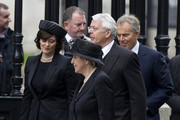Former British Prime Ministers John Major (C) and Tony Blair (R) and wives Cherie Blair (L) and Norma Major (C) attend the funeral service of Baroness Thatcher at St Paul's Cathedral on April 17, 2013 in London, England. Dignitaries from around the world today join Queen Elizabeth II and Prince Philip, Duke of Edinburgh as the United Kingdom pays tribute to former Prime Minister Baroness Thatcher during a Ceremonial funeral with military honours at St Paul's Cathedral. Lady Thatcher, who died last week, was the first British female Prime Minister and served from 1979 to 1990.