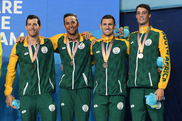 Swimming - Commonwealth Games Day 6 [team,uniform,medal,player,award,gold medal,championship,team sport,bronze medal,crew,medley relay final,bronze medalists,calvyn justus,cameron van der burgh,chad le clos,bradley tandy,south africa,mens 4,commonwealth games,medal ceremony]